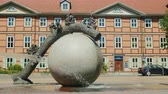 sculpture : Wernigerode, Germany, May 2018: The original fountain in the form of a ball, it has a tree trunk and sculptures. Small cities in Germany