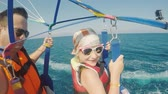 paragliding : Dad and daughter are flying on parasailing. A father takes a selfie with a girl, an active vacation with a child