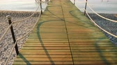 wood flooring : Walk on a wooden pier to the sea, a first-person view Stock Footage