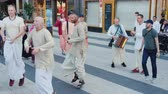 hare : Stockholm, Sweden, July 2018: A group of happy Hare Krishnas dance and sing in the center of Stockholm Stock Footage