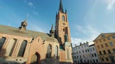 Tilt shot: Famous church with an metal spire in Stockholm - Riddarholmen Church.