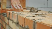 bricklayer : An experienced worker makes a brick wall masonry
