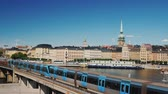 szwecja : The cityscape of Stockholm, in the foreground the train passes. Transport in the capital of Sweden