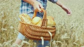 produtos de panificação : A young woman farmer carries in a wicker basket freshly baked bread made from wheat flour from an environmentally friendly own grain production