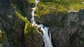 skandynawia : Tilt dawn shot: The famous waterfall Voringsfossen in Norway. Impressive beauty of Scandinavian nature