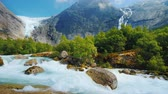 north stream : The incredible nature of Norway is a turbulent river from the melted waters of the Briksdal Glacier Stock Footage