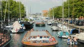 denmark : Copenhagen, Denmark, July 2018: A lively canal with the movement of yachts and sightseeing boats.