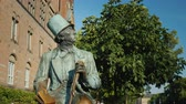 bilinen : Copenhagen, Denmark, July 2018: Monument to Hans Christian Andersen in Copenhagen, Denmark Stok Video