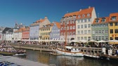 Копенгаген : Copenhagen, Denmark, July 2018: Nahavn is a popular place among tourists. One of the most recognizable places in Copenhagen, the business card of the city