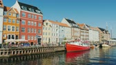 denmark : Copenhagen, Denmark, July 2018: The famous and well-recognized canal Nahavn, the visiting card of the city of Copenhagen