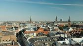 kopenhag : The city of Copenhagen, an old city often with old-tiled roofs and spiers. Pan shot
