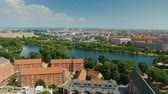 copenhague : Beautiful city of Copenhagen, view from the heights. Houses with tiled roofs and a river. Pan shot