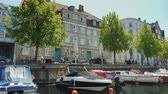 denmark : Copenhagen, Denmark, July 2018: View from the sightseeing boat that sails through the canals of Copenhagen Stock Footage