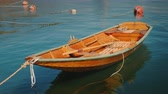 pescador : A new wooden boat is moored offshore