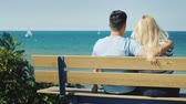 namorado : Young multi-ethnic couple resting on a bench overlooking Lake Ontario