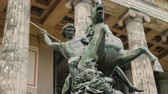 speer : Berlin, Germany, May 2018: Sculpture of a rider with a spear at a defeated lion at The building of the Old National Gallery, steadicam shot Stockvideo