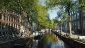 歩道橋 : Beautiful places in Amsterdam - a cozy channel with barges, traditional bikes parked off the coast 動画素材
