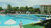 все : Kemer, Turkey, June 2018: Well-groomed territory with a swimming pool in a Turkish hotel. Everything for a comfortable rest on the all-inclusive system Стоковые видеозаписи
