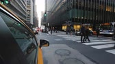 kereszt : New York, USA, September 2018: Yellow New York taxi rides through the streets of Manhattan