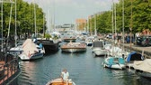 denmark : Copenhagen, Denmark, July 2018: A lively historic canal with the movement of yachts and sightseeing boats. Stock Footage
