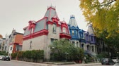 ピニオン : Montreal, Canada, October 2018: Colorful Victorian Houses in Square Saint Louis - Montreal, Quebec, Canada. Beautiful multi-colored roofs 動画素材