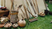 tribo : Indians household items near traditional housing - wigwam