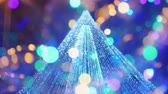 背の高い : Bokeh and blurry lights of a Christmas tree. Christmas background 動画素材