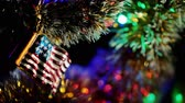 kerst huis : Toy in the form of an American flag on a Christmas tree Stockvideo