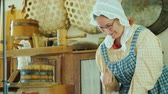 krug : Genesee, NY, USA, July 2019: Woman cooks butter according to an old traditional recipe