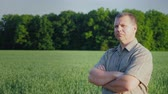 Middle-aged self-confident farmer examines his field. The owner of a small business concept