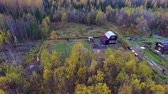 Small House in Autumn Woods. Little farm in the middle of a forest in autumn. Around the little forest home. People work