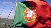 такелаж : Portuguese flag on a ship on sky background