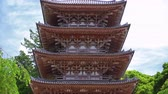 five story wooden pagoda in a green park, zooming out