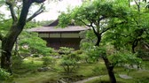 ancient wooden building in the ginkakuji temple park, sliding shot