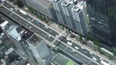 elevated road in Tokyo skyline, zooming out aerial view