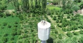 pintos : Storks in the nest on water tower. Drone camera from above