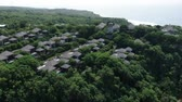 quai : Flying drone over a mountain road near the sea among palm trees in Bali, Indonesia Vidéos Libres De Droits