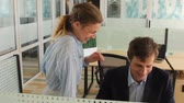 kacérkodás : Young woman flirting with man in office Stock mozgókép