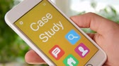 teoria : Case study concept application on the smartphone. Man uses mobile app. Vídeos