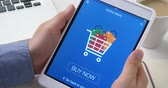 Buying goods in online store using digital tablet Stock Footage
