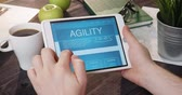 Looking at agility internet page using digital tablet