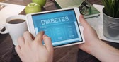 Reading diabetes internet page using digital tablet