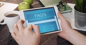 Browsing FAQS using tablet computer Stock Footage