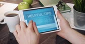 Reading helpful tips using digital tablet Stock Footage