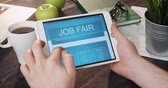 Checking job fair internet page using digital tablet Stock Footage