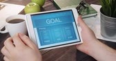 Reading about goal using tablet computer