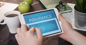 Checking insurance info using digital tablet Stock Footage