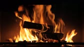 hotbed : heating, warmth, fire concept - close up of burning fireplace at home