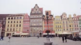 Wroclaw,Poland- September 14, 2017: View from arch to cityscape of old town Market Square with colorful historical buildings.