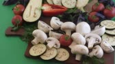 comestível : Champignon and fresh vegetables on a kitchen table for cooking dishes from mushrooms